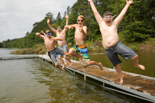 Kids Jumping off a Dock
