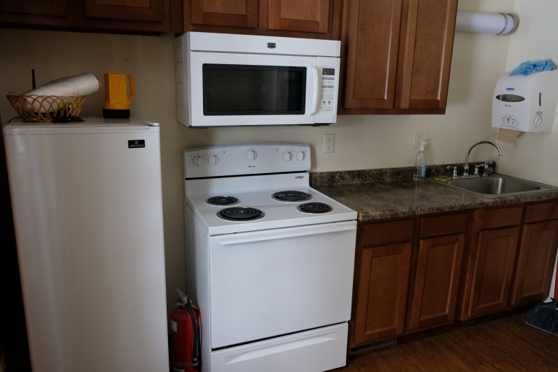 Refrigerator Stove and Microwave next to counter